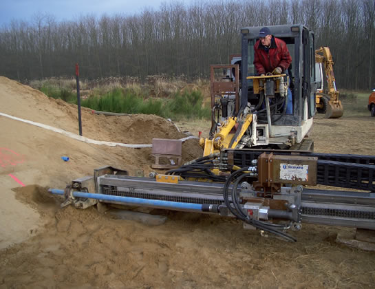 Standard drilling is to be applied to implement the linear drainage elements in the model dyke (Performed by: Morath GmbH, Albbruck)