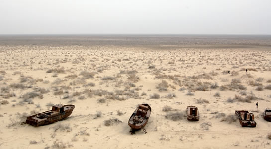 A ship graveyard on the dried up ground of the Aral Sea