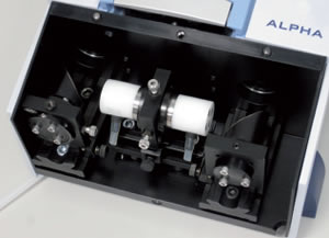 An ATR measurement module for recording infrared absorption spectra (the sensor fibre is located on the cylindrical measuring cell, through which the water sample flows via the two water connections.)